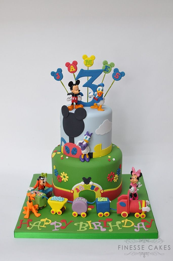 Kids fun themed birthday cake 2 tiers with plastic disney models added by client
