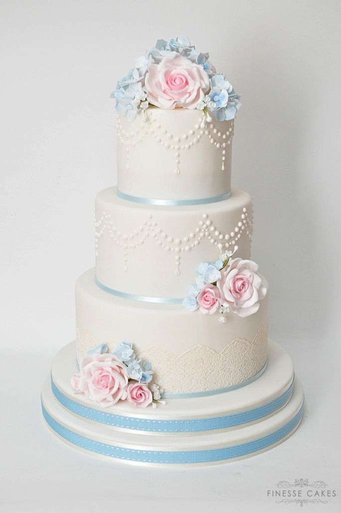 elegant white pink blue roses wedding cake