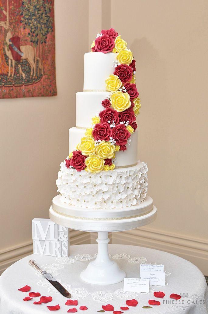 red yellow roses cascade wedding cake ruffles rochford essex