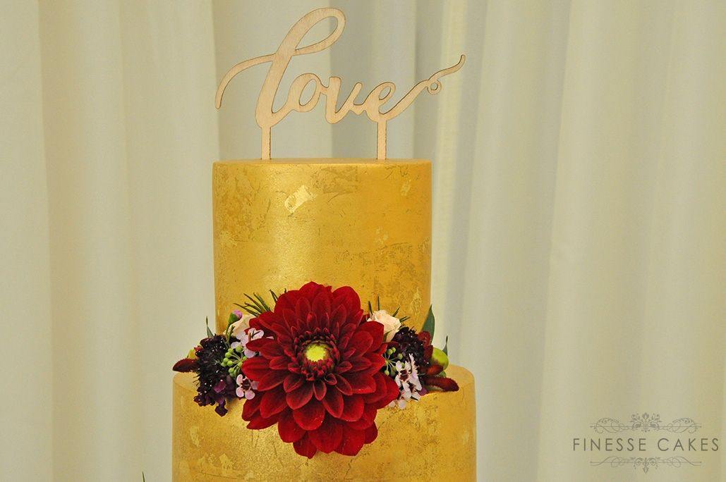 aged gold 3 tier gold leaf wedding cake fresh flowers high house essex